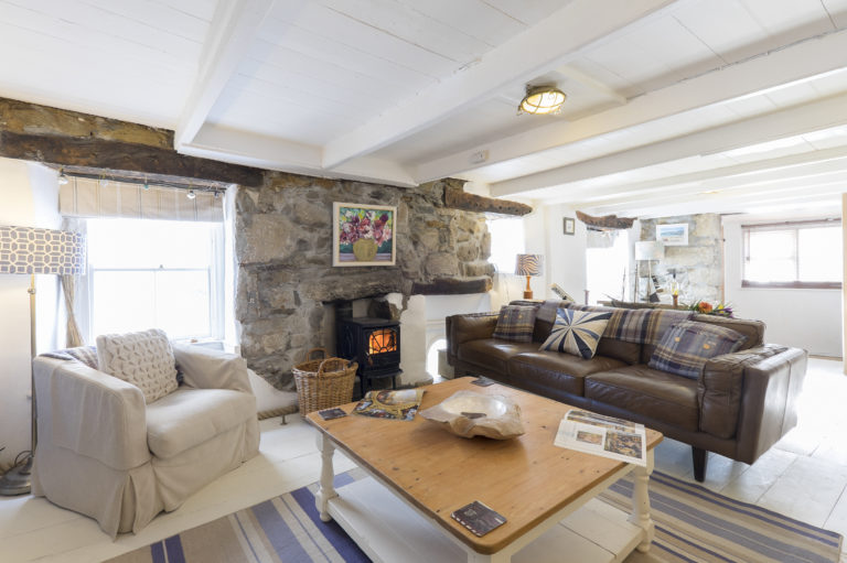 Trelawney Cottage St Ives Fisherman's Cottage Sitting Room Woodburner with granite surround and comfy sofa